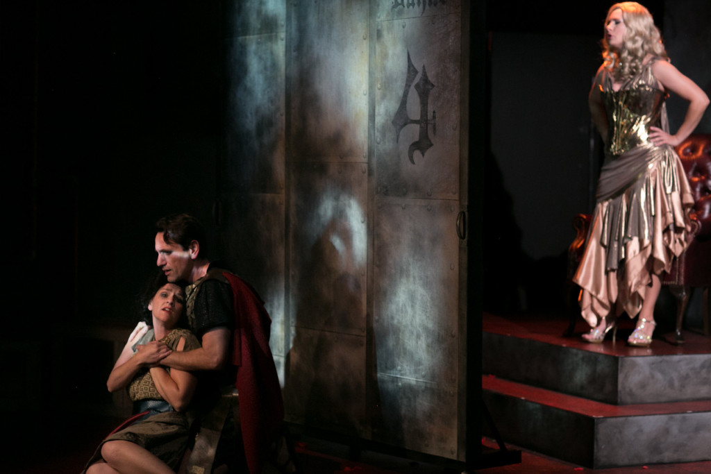 Tiffany Tang as THE EXTRA and John DeCarlo as THE MAN